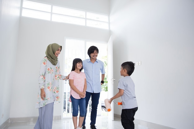 Family entering new house to buy