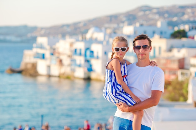 Family in europe. father and little girl in little venice in mykonos