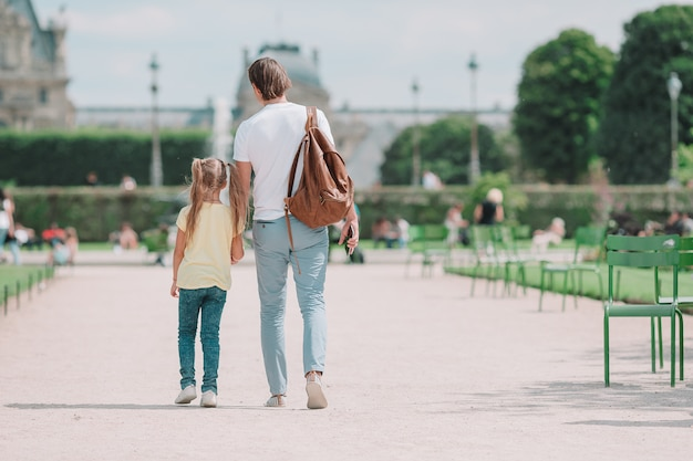 Family in european city, paris, france. french summer holidays, travel and people concept.