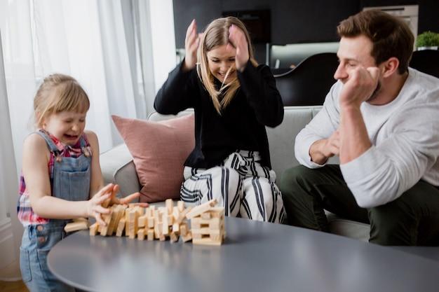 Family and falling jenga tower