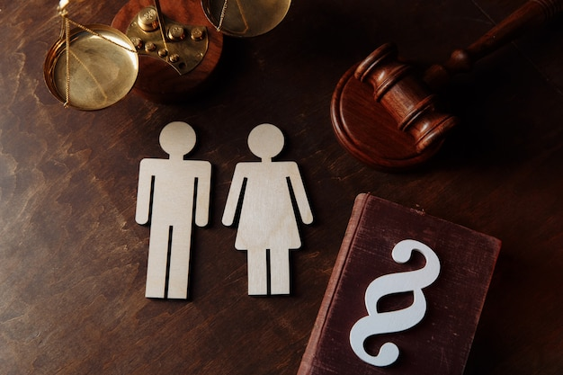 Family figures paragraph sign and law book divorce and separation