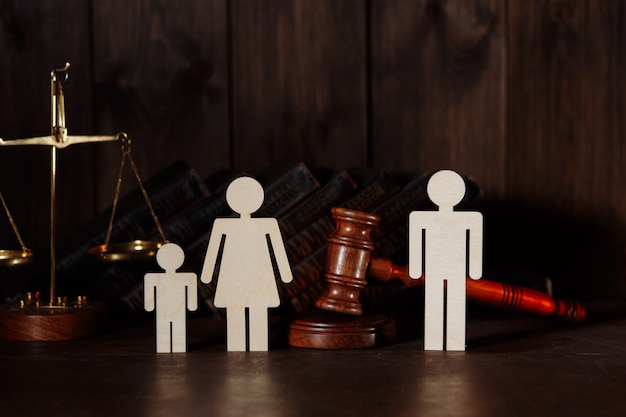 Family figures with judge gavel. divorce and separation concept