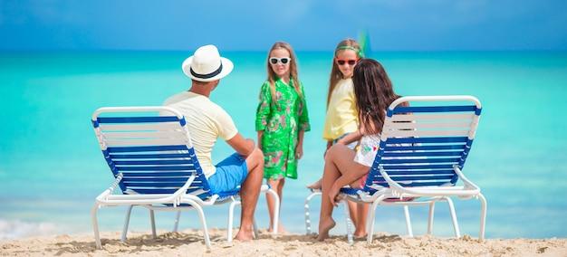 Family of four on beach holidays