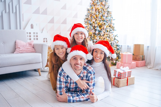 Family of four on christmas at home