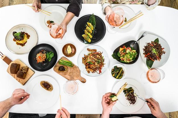 Family, friends gathering dinner.