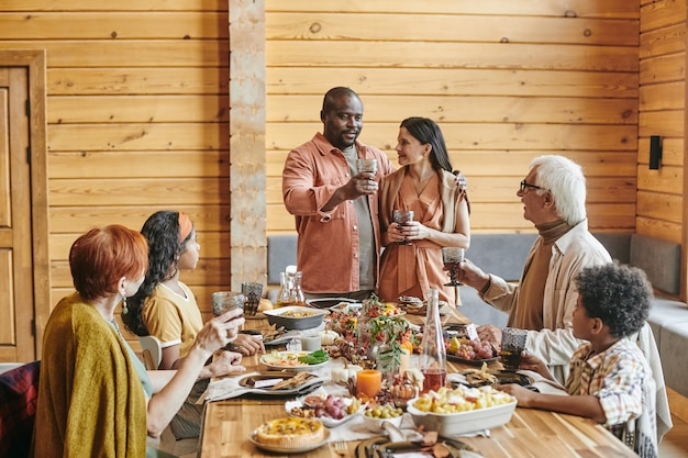 Family gathering at dining table