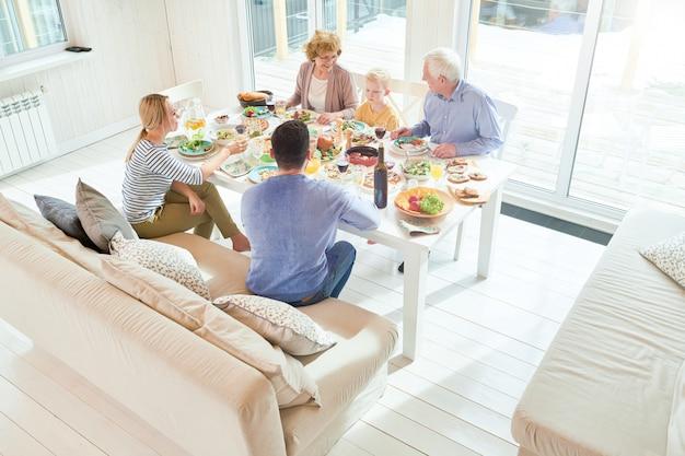 Family gathering at dinner in sunlight