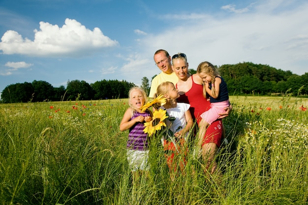 Family in a grass field