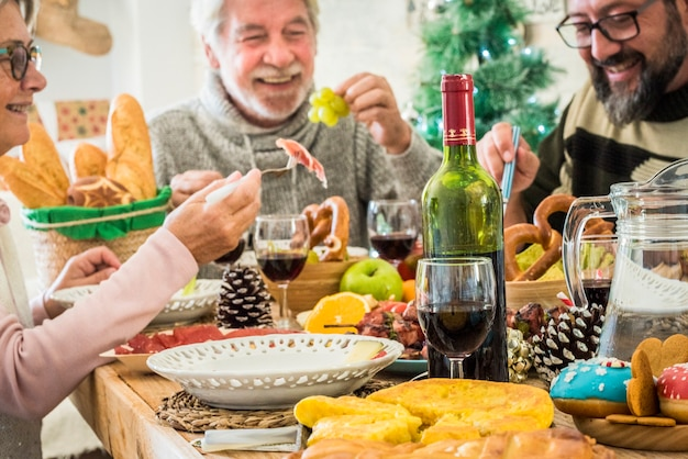 Family group people enjoy lunch together in christmas days season