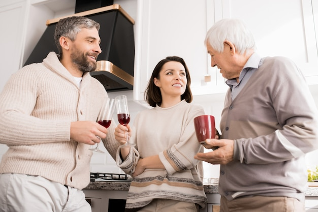Family having casual drink at home