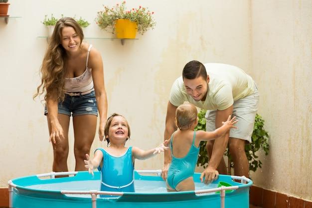 Family having fun in kids pool