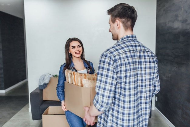 Family having fun in new house while unpacking things
