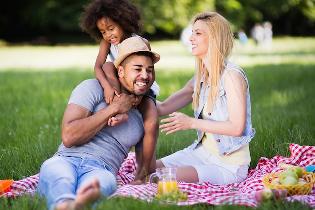 Family having fun and smiling while  picnicing in nature