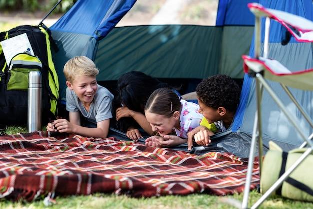 Family having fun in the tent
