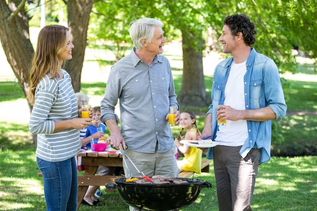 Family having a picnic with barbecue