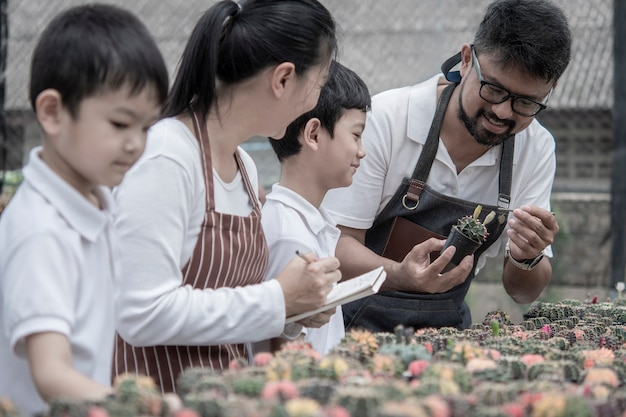 Family help takes care of the cactus garden