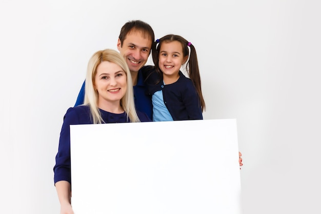 Family holds holds a large photo canvas