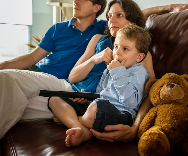 Family holiday watching tv at home lifestyle