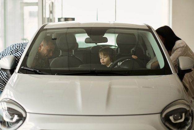 The family is considering the interior of their future car.
