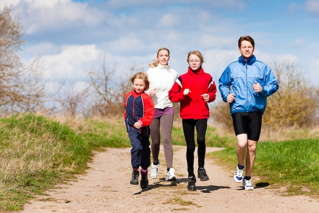 Family is running outdoors
