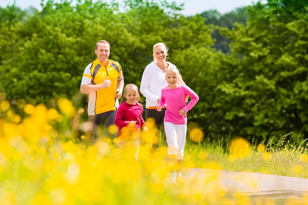 Family jogging in the meadow for fitness