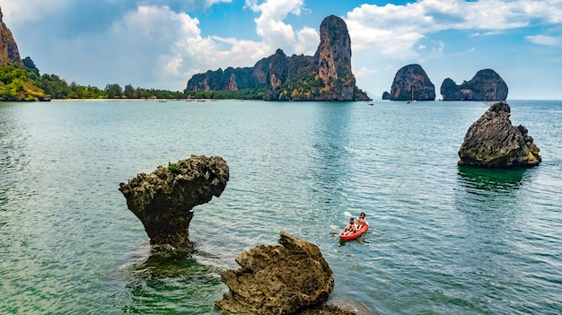 Family kayaking, mother and daughter paddling in kayak on tropical sea canoe tour near islands, having fun, active vacation with children in thailand, krabi