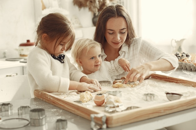 Family in a kitchen. beautiful mother with little daughter.