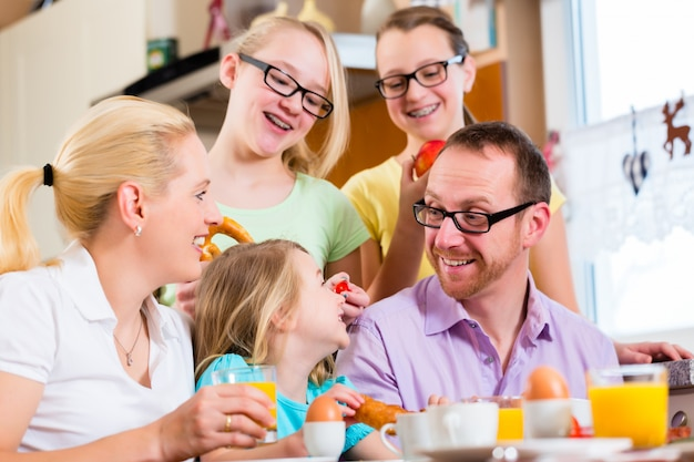 Family in kitchen having breakfast together
