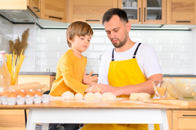 Family knead the dough with bare hands front view