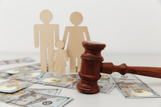Family law or divorce concept family figure with judge gavel