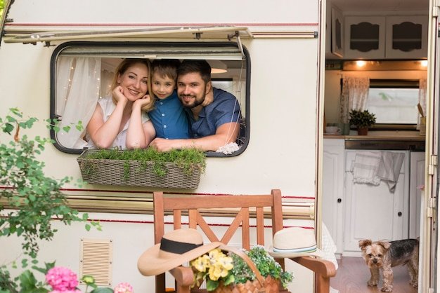 Family looking out of a caravan's window