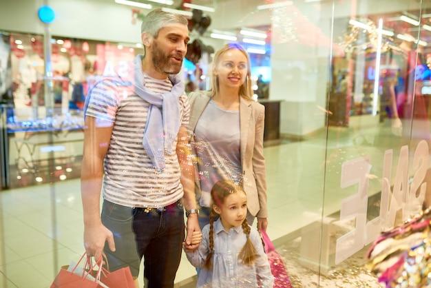 Family looking at shopping displays