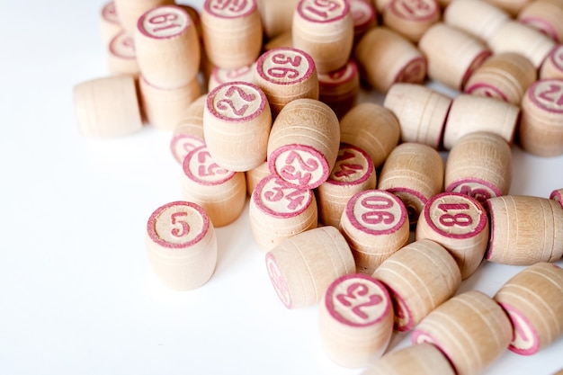 Family lotto board game. barrels with numbers.