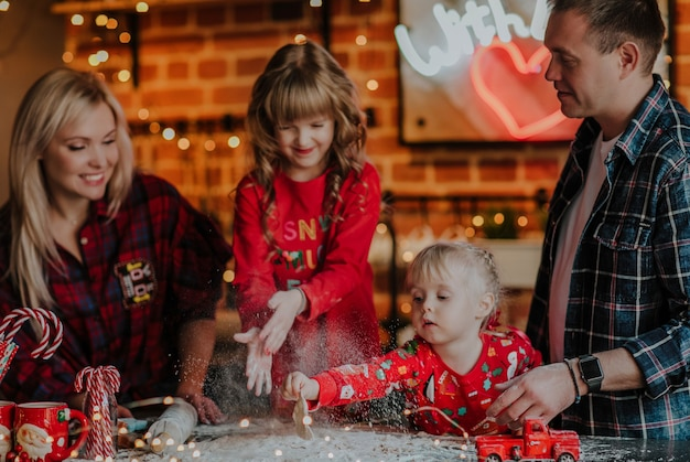 Family making christmas cookies