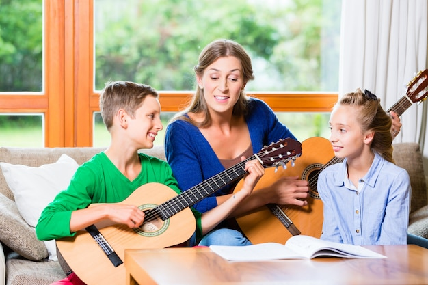 Family making music with guitar
