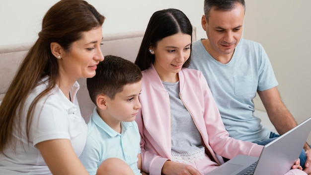 Family members using a laptop
