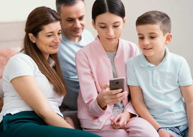Family members using a mobile phone