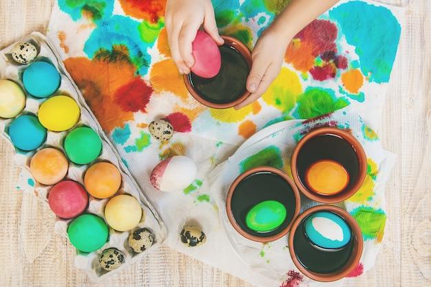 Family paints easter eggs. selective focus. celebration.
