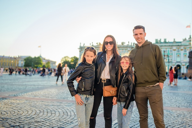 Family of parents and little girls visiting the hermitage, saint-petersburg.