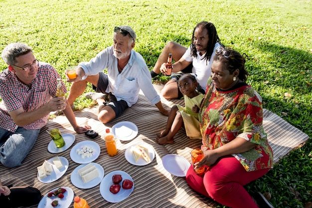 Family picnic outdoors togetherness relaxation concept