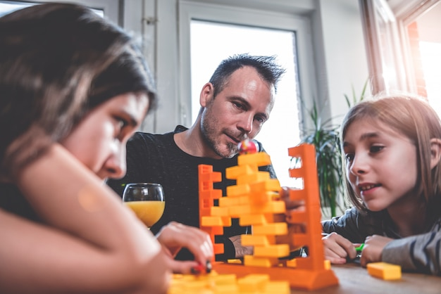 Family playing board games at home
