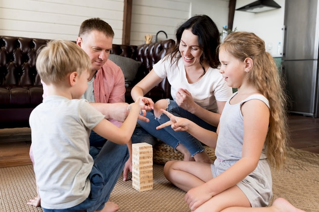 Family playing game in living room