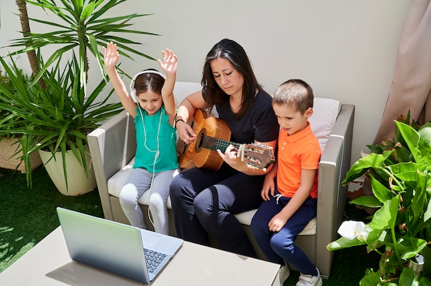 Family playing the guitar in quarantine time