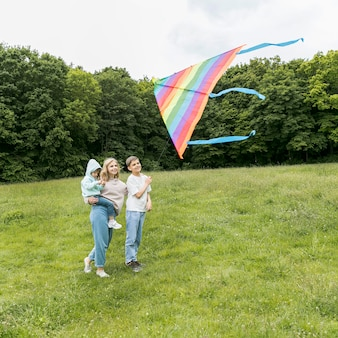 Family playing with a kite