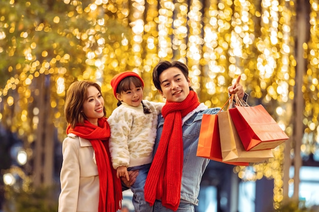 Family portrait celebrating christmas and new year with holidays and shopping