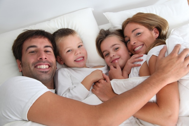 Family portrait laying in bed