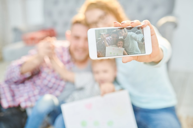 Family portrait on smartphone screen
