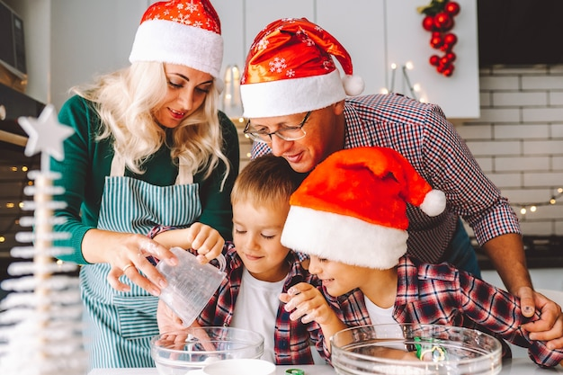 Family preparing cookies for xmas eve