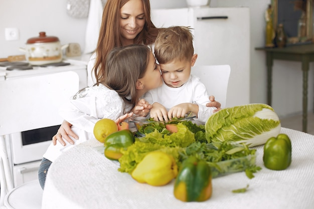 Family preparing a salad in a kitchen