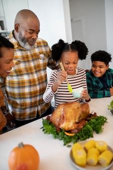 Family preparing the thanksgiving day turkey